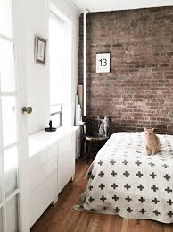sunny bedroom with ikea besta pia wallen exposed brick wall and