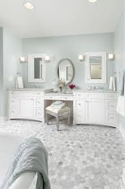 bathroom with carrara marble floors and white cabinets also wall