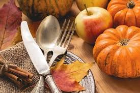 autumn thanksgiving table setting with empty plate cutlery and