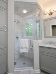 Gray And White Bathroom - fixer upper marble countertops marble floor and white cabinets