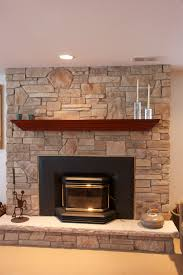modern stone fireplace mantels ideas facing cozy black sofa on