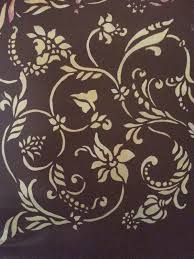 wall painting flower stencils with charming gold and brown color