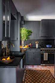 two tone kitchen cabinets with black countertops how black became the kitchen s it color architectural digest