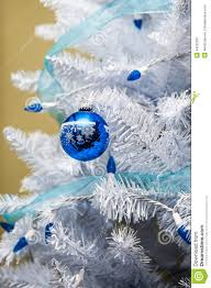 white tree with blue lights lights decoration