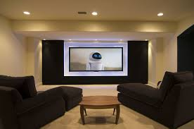 media room basement with modern big lcd tv and cozy black day bed