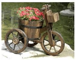 come sit in my garden vintage rustic wooden wheelbarrow