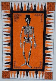 halloween paper border mr chillingsworth panel quilt made with 22 5 degree spikey