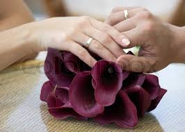 wedding rings on of the groom and the with wedding rings on the flowers
