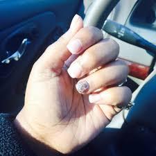 thin acrylic nails with natural nail color and a glitter nail on