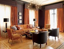 Burnt Orange And Chocolate Brown Infuse This Room With Autumn - Grey and brown living room decor ideas