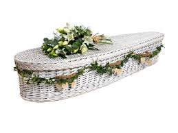 wicker casket tributes willow teardrop coffin in white with flowers and