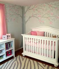 how to create a tree themed children s bedroom disney mural soft pink and gray painted walls ceiling and floral tree mural in baby g s