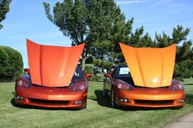 atomic orange corvette convertible for sale 2005 06 daytona sunset orange on left and 2007 09 atomic orange on