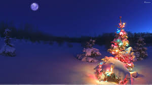 lighting christmas tree in snowfall wallpaper
