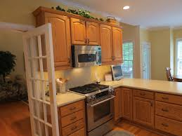 kitchen paint colors with oak cabinets and black appliances with