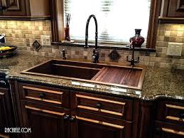 custom copper and stainless sinks for the kitchen and bathroom