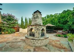 Sided Outdoor Fireplace - sparkman club traditional feels modern inside has epic pool