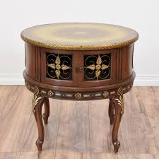 this pair of queen anne style end tables are featured in a solid