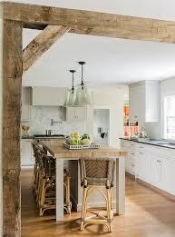 modern kitchen with butcher block island table herringbone marble