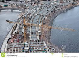 yellow liebherr tower crane works on construction of the bridge