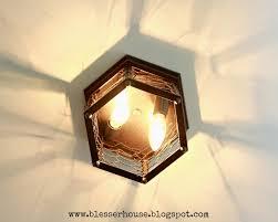 thrifted chicken wire light fixture bless u0027er house