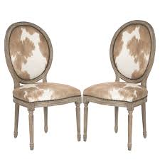 cowhide side chairs with nail head trim brown and white