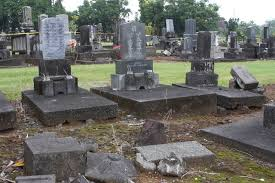headstones cost a grave concern county says insurance should cover cost of