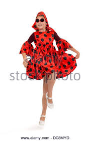 teen in a red polka dot dress on a white background stock