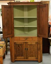 found in ithaca antique chestnut corner cabinet interior