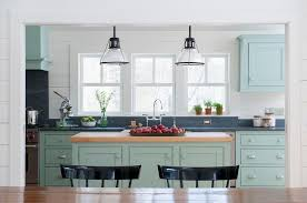 light blue kitchen cabinets with dark gray counters country