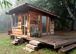 secret offgrid cabin in the forest built from salvaged materials