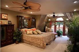 tropical master bedroom with built in bookshelf u0026 ceiling fan in