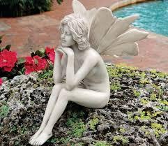 the secret garden fairies pondering statue gardensite co uk