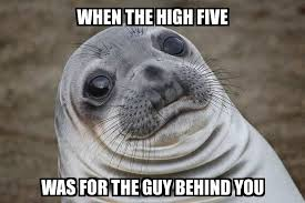 High Five Meme - awkward moment seal when the high five was for the guy behind