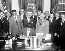 ar6733 b president john f kennedy signs s 857 authorizing
