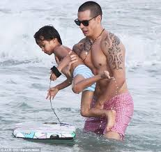 jennifer lopez snaps pictures of her twins as she hits the beach