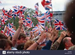 flag waving outside buckingham palace at the golden jubilee