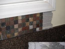How To Install Glass Mosaic Tile Backsplash In Kitchen by Installing Kitchen Tile Backsplash Hgtv