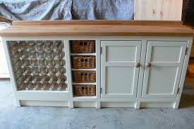 freestanding kitchen unit with basket and wine rack features the