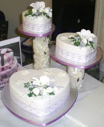 heart shaped wedding cakes heart shaped wedding cakes with white flowers wedding ideas