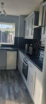 grey kitchen cabinets b q diy enthusiast describes how she used paint to create an