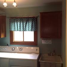 a peek at our laundry room u0026 the world u0027s easiest no sew window