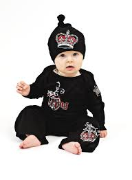 baby designer clothes shop has baby clothes that rock beds