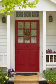 painted front door for the guest house doors paired with black shutters and the