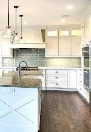 glass backsplash for kitchens contemporary white kitchen with gray glass backsplash