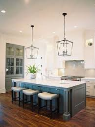 lights for kitchen island white and blue kitchen features white cabinets painted benjamin