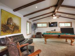 family game room with wet bar pool table ping pong darts and