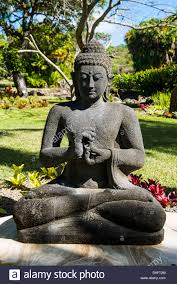 buddhist statues in the botanical gardens in nevis island st