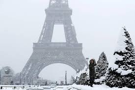 photos of snow photos eiffel tower shuts down as blanket of snow covers paris see