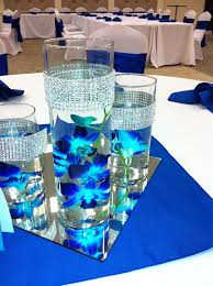 blue centerpieces submerged blue orchids with bling wrap trimmed vases can top with